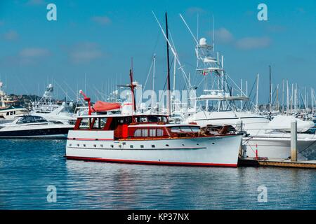 Historic vintage cabin cruiser yacht docked in the bay in San Diego California - Stock Photo
