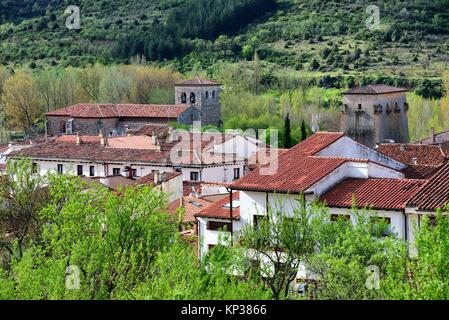 panoramic view of of Covarrubias, in front red roofs of houses, on left bell tower of Collegiate church of Saints - Stock Photo