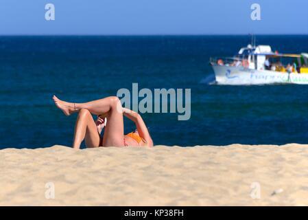 leisure on the beach, Batata beach, Atlantic Ocean, Lagos, city center, Algarve, Portugal, Europe - Stock Photo