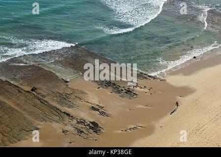 walking on Porto de Mos beach, Lagos, Algarve, Portugal, Europe - Stock Photo