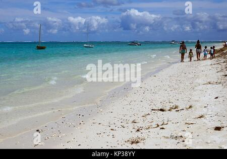 young mothers with kids on Pointe D'Esny beach - Paradise Beach, South East Coast of Mauritius, picturesque, tropical - Stock Photo