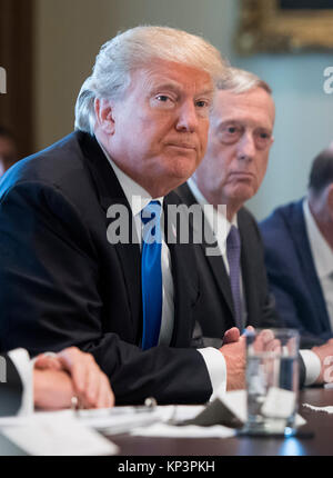 Washington, USA. 06th Dec, 2017. United States President Donald J. Trump speaks alongside Defense Secretary Jim - Stock Photo