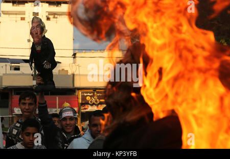 Gaza City, Gaza Strip, Palestinian Territory. 13th Dec, 2017. Palestinians take part in a protest against US President - Stock Photo