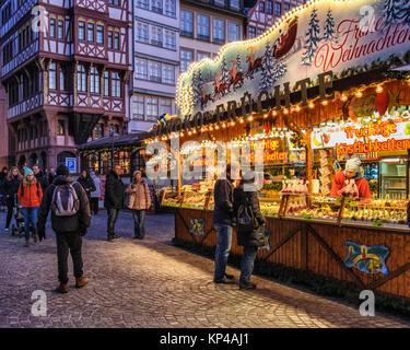Frankfurt,Germany. Traditional German Market stalls on Römerberg with historic half-timber terraced houses, - Stock Photo