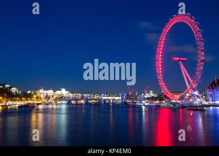 London skyline at night with the London Eye on the right. - Stock Photo