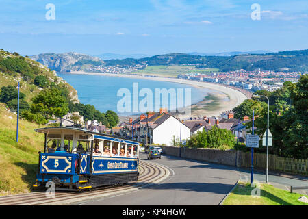north wales llandudno north wales Llandudno view of Llandudno bay with tram train of the great orme tramway going - Stock Photo