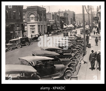 Model T Fords by the dozen parked in line in the busy Main Street of Colfax, Washington State USA - Stock Photo