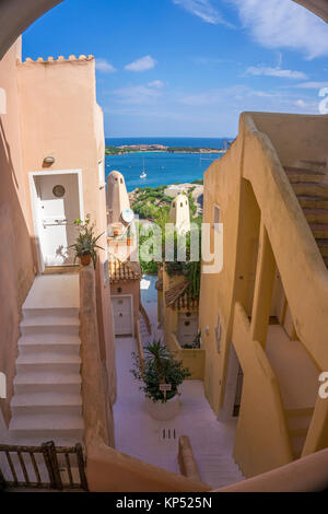 View between houses entrance of the Marina, Yacht harbour of Porto Cervo, luxury destination at Costa Smeralda, - Stock Photo