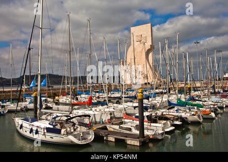 Marina de Belém harbour, on background Monument to the Discoveries, Santa Maria de Belém district, Lisbon, Portugal, - Stock Photo