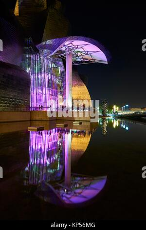 Guggenheim Museum at night with spectacular light, Bilbao, Biscay, Basque Country, Spain - Stock Photo