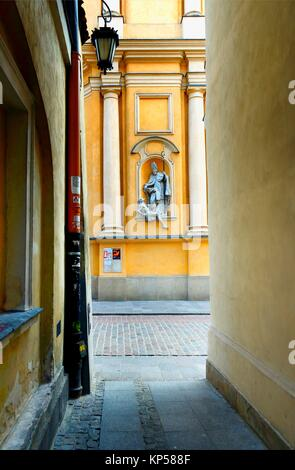 Architectural detail - symbols in arts - Saint Martin helps poor man, St. Martin's Church - Kosciol Sw. Marcina, - Stock Photo