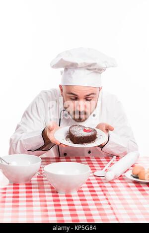 Kuchenbaecker - cake baker - Stock Photo