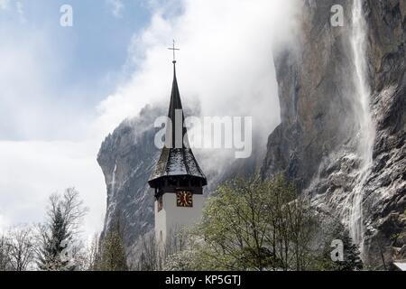 Landscape with church in Lauterbrunnen Junfrau region Berner Oberland Switzerland. - Stock Photo
