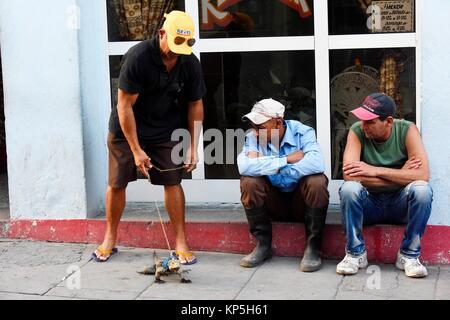 Man with iguana, Santa Clara, Cuba. - Stock Photo