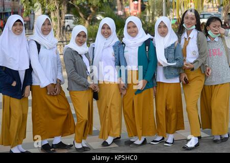 Group of Muslim School Girls in Makassar,(formerly Ujung Pandang), Sulawesi island,Indonesia. - Stock Photo