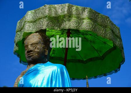 Buddha statue at the ruined temple at Wat Phou in Laos,Southeast Asia. - Stock Photo