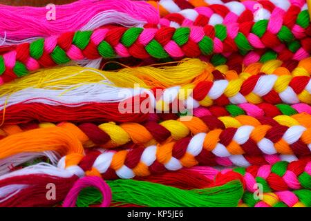 Multi colored wool for sale in Luang Prabang market,Laos,Southeast Asia. - Stock Photo