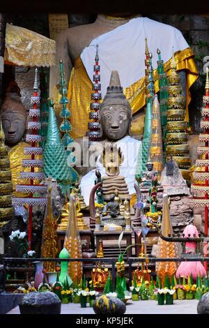 A Buddhist shrine inside Wat Phu,a ruined Khmer Hindu temple complex in Champassak, South Laos,Southeast Asia. - Stock Photo