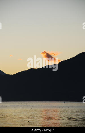 sunrise at lake Atitlan in Guatemala - Stock Photo