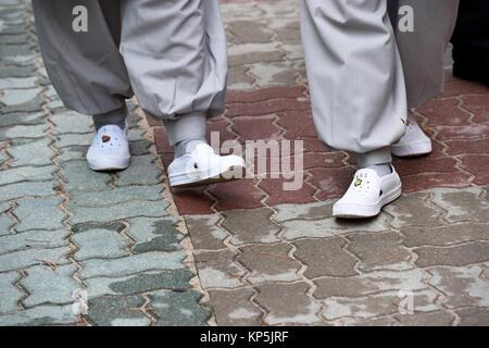 Buddhist monks at Jogyesa Temple,close-up of feet,Seoul,South Korea. - Stock Photo