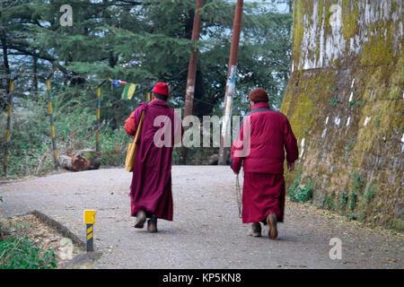 Buddhist monks walking along road at Mcleod Ganj, Himachal Pradesh, India - Stock Photo