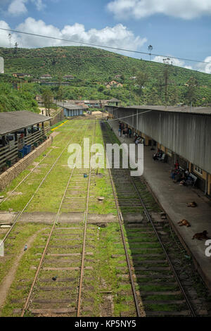 People wating on the platforms at Nanu Oya, Railway station in Central Province, Nuwaraelyia District, Sri Lanka - Stock Photo