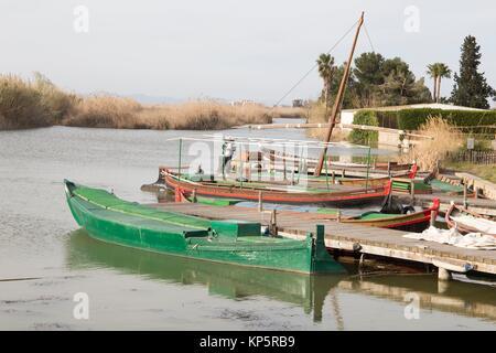 Fishing boats in La Albufera lake nature reserve, El Palmar, Valencia, Comunidad Valencia on March 8, 2017. - Stock Photo