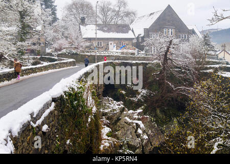 Pont-y-Pair old bridge circa 1470 over Afon Llugwy River in Snowdonia village with snow in winter 2017. Betws-y - Stock Photo