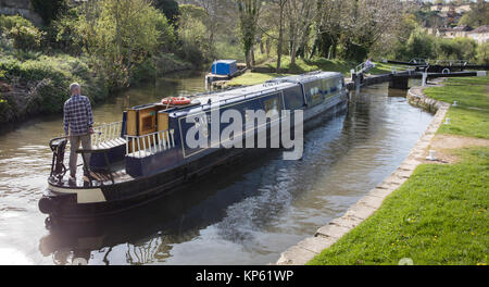 Narrow boat barge approaching a lock on the Kennet and Avon Canal as it passes through Bath Somerset UK - Stock Photo