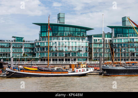 Boats at Hermitage Community Moorings and riverside apartments at Wapping, London, UK - Stock Photo