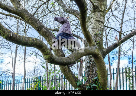 A toy horse in a tree in Finsbury Park, North London, UK - Stock Photo