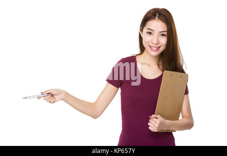 Girl with folder and pen show out - Stock Photo