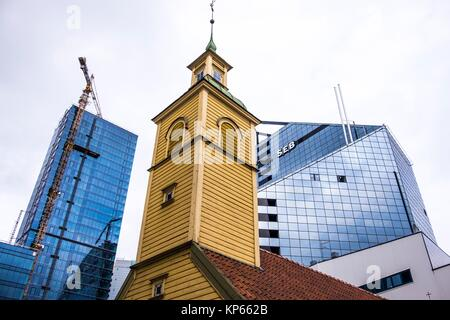 Church in front of a high rise building in Tallinn, Estonia, Europe. - Stock Photo