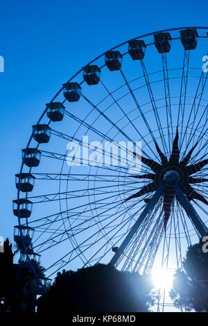 Ferris Wheel in Sunset in Nice in Provence-Alpes-Côte d´Azur, France. - Stock Photo