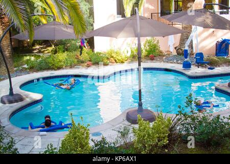 People enjoying and lounging in the luxurious swimming pool in a luxury hotel and resort in the Sonoma region of - Stock Photo