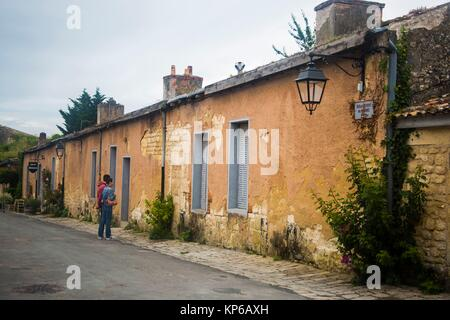 Old streets with small old houses in the region of medic, Bordeaux, France. Old parisian typical lights are hanging - Stock Photo