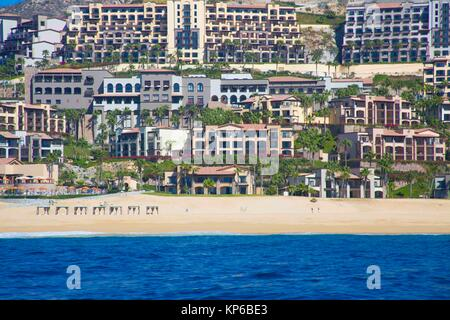 View from the ocean of the colorful houses, resorts, and apartments on the beach of Cabo San Lucas. You can see - Stock Photo