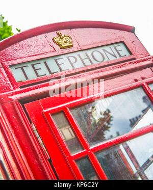 Classic red British telephone booth or boxes with no Big Ben in the background on the left by a clear no rainy day. - Stock Photo