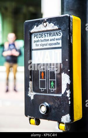 Typical pedestrian yellow right of crossing in England. - Stock Photo