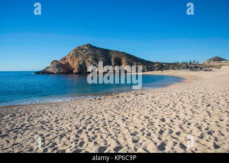 Empty beach in Cabos San Lucas, Baja California, Mexico. Ocean and mountains on a blue sky and sunny day. - Stock Photo