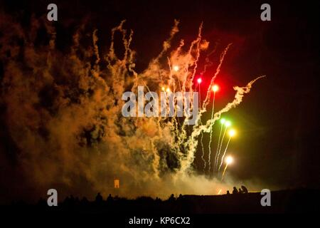 Colourful exploding firework during a fireworks celebration. - Stock Photo