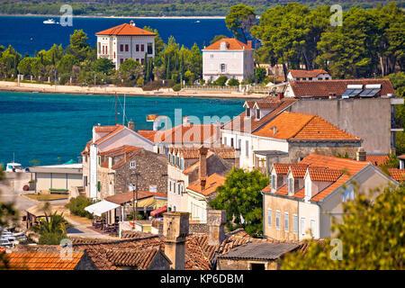Island of Zlarin waterfront and architecture view, Sibenik archipelago of Dalmatia, Croatia - Stock Photo