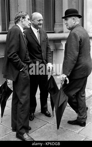 1970s City of London UK men wearing bowler hat and carrying rolled umbrellas, dress code for the 70s. Middle aged - Stock Photo