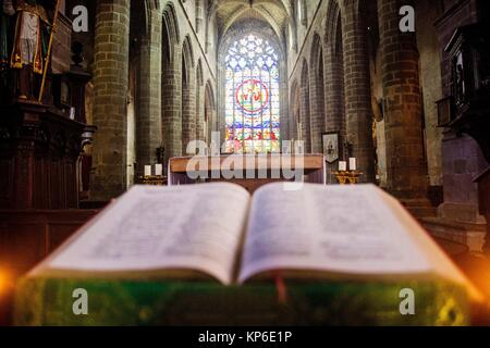 View from the pulpit where the priest, preacher or minister preaches and reads his bible. From view close up of - Stock Photo