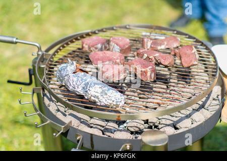 Rindersteak am Grill - beef steak on barbecue - Stock Photo