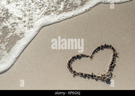 Herz im Sandstrand - heart in sand - Stock Photo