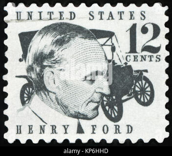 UNITED STATES OF AMERICA - CIRCA 1968: A stamp printed in USA shows Henry Ford (1863-1947) and car Ford Model T - Stock Photo