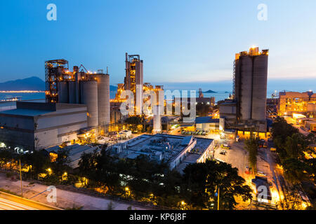Cement plant at night - Stock Photo