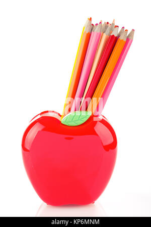 Colorful pencils in apple shaped stand - Stock Photo