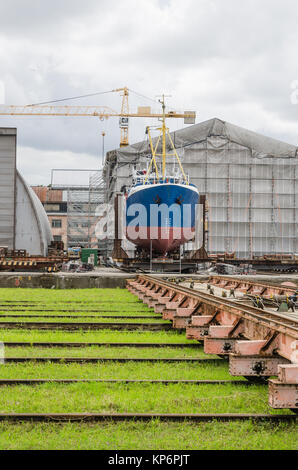 The ship on the stocks in the shipyard - Stock Photo